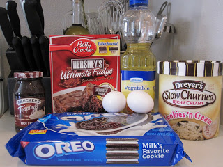 Oreo Stuffed Brownies are gooey, rich brownies filled with fudge, Oreos, and ice cream. Life-in-the-Lofthouse.com