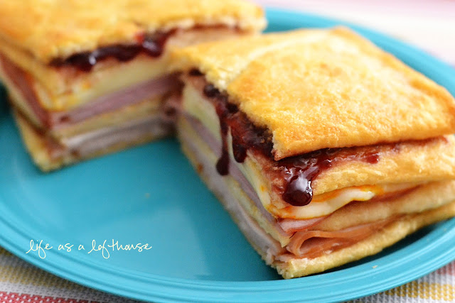 Monte Cristo Sandwiches are buttery flaky crescents filled with ham, turkey, cheese and raspberry jam. Life-in-the-Lofthouse.com