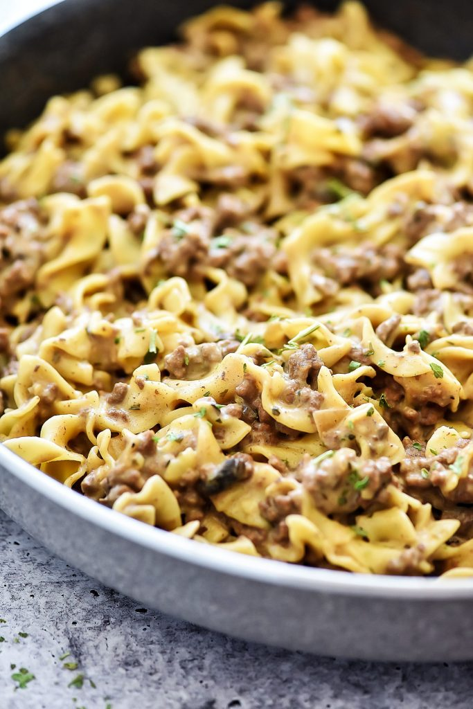 Easy Beef Stroganoff is filled with ground beef and a mushroom sauce served over egg noodles. Life-in-the-Lofthouse.com
