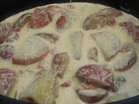 Slow Cooker Scalloped potatoes and Ham Alfredo is red potatoes and diced ham covered in a flavorful Alfredo sauce. Life-in-the-Lofthouse.com
