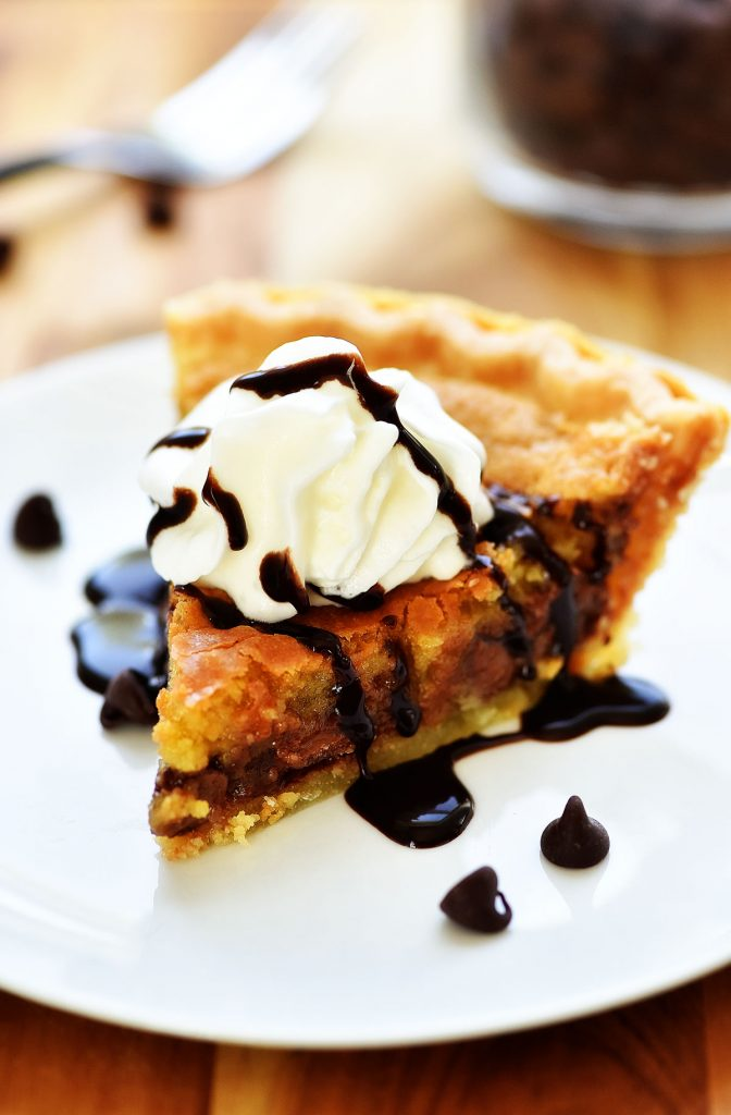 Chocolate Chip Cookie Pie is everything you love about a warm, soft chocolate chip cookie but in pie form. Life-in-the-Lofthouse.com