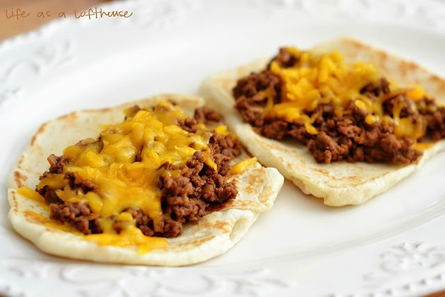 Cheeseburger Flatbread Melts are made up of a 'burger' meat mixture topped off with shredded cheddar cheese that is wrapped up in a flatbread. Life-in-the-Lofthouse.com
