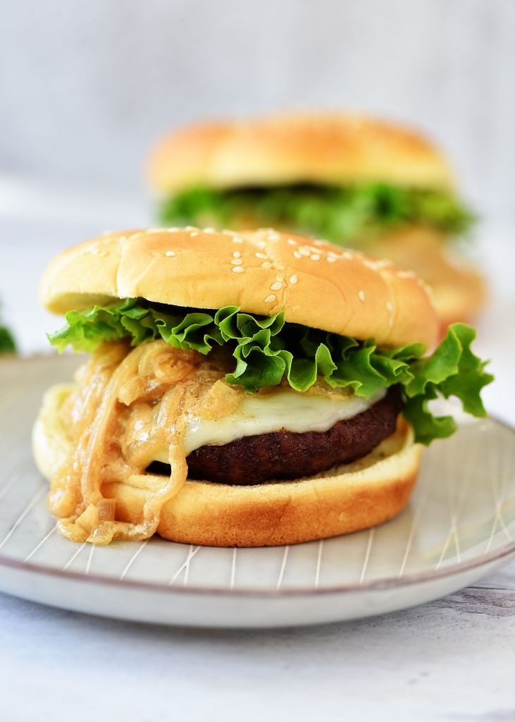 French Onion Burgers are loaded with provolone cheese and caramelized onions. Life-in-the-Lofthouse.com