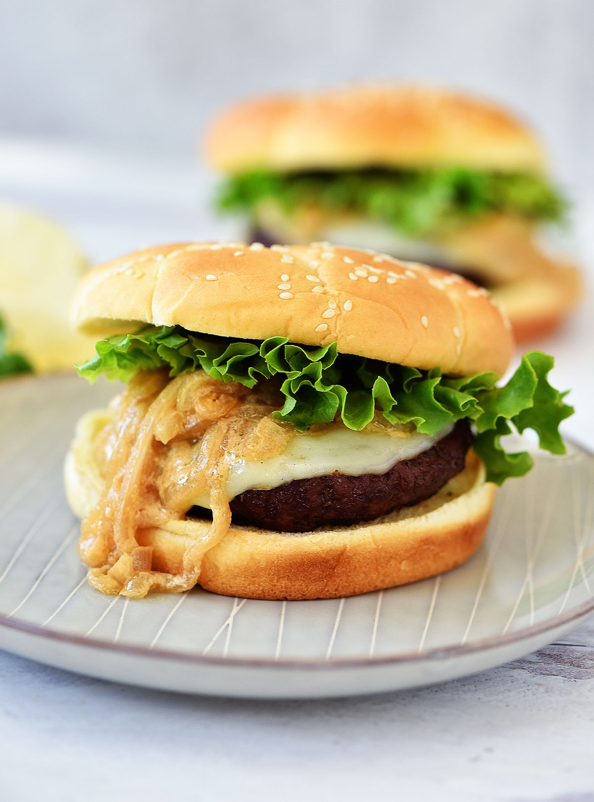 French Onion Burgers are loaded with provolone cheese and sautéed onions. Life-in-the-Lofthouse.com