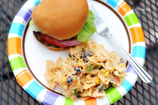 Fiesta Chicken Pasta Salad is full of tender pasta and chicken that is mixed with taco seasoning, ranch dressing, corn and black beans. Life-in-the-Lofthouse.com