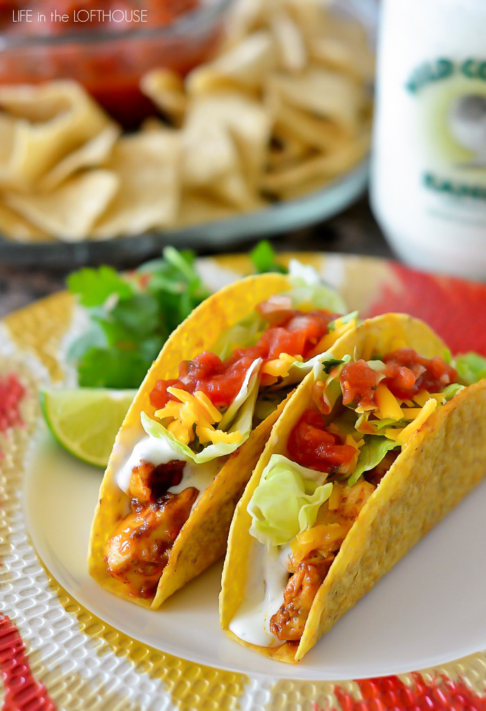 Chicken Ranch Tacos are filled with flavorful chicken, ranch dressing and all your favorite taco toppings inside crispy taco shells. Life-in-the-Lofthouse.com