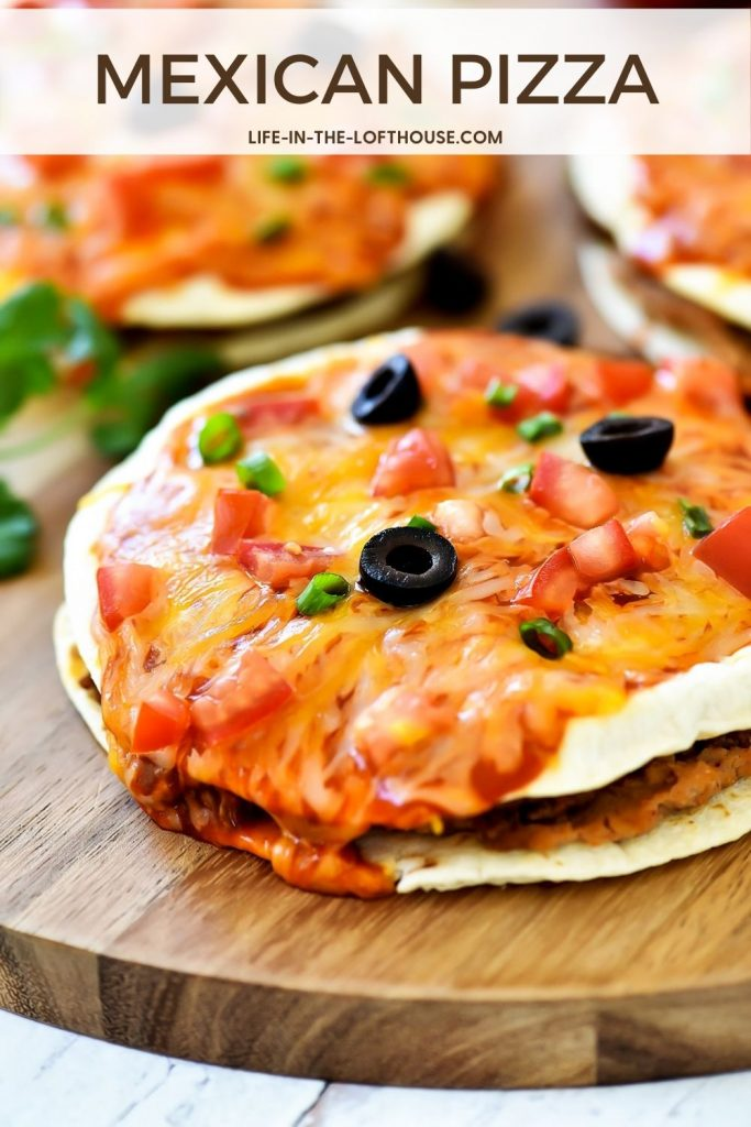 Mexican Pizza is filled with seasoned ground beef, beans, cheese and enchilada sauce stuffed between two golden flour tortillas. Life-in-the-Lofthouse.com