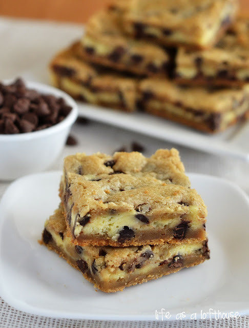 Cheesecake chocolate chip cookie bars are soft, divine, chocolate chip cookie bars with a cheesecake center. Life-in-the-Lofthouse.com