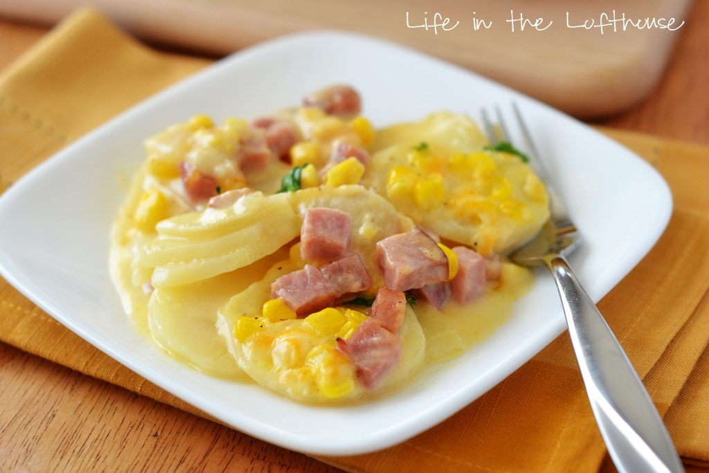Delicious cheesy and buttery scalloped potatoes covered in ham and corn. Life-in-the-Lofthouse.com