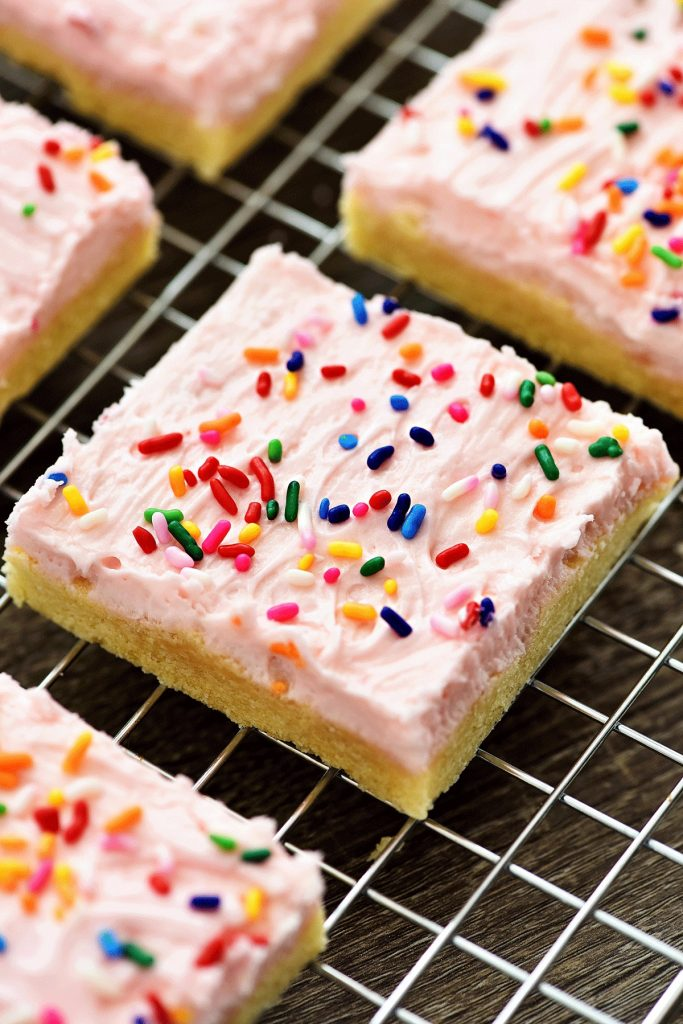 Sugar Cookie Bars are soft, thick sugar cookies in bar form with a delicious, creamy frosting. Life-in-the-Lofthouse.com