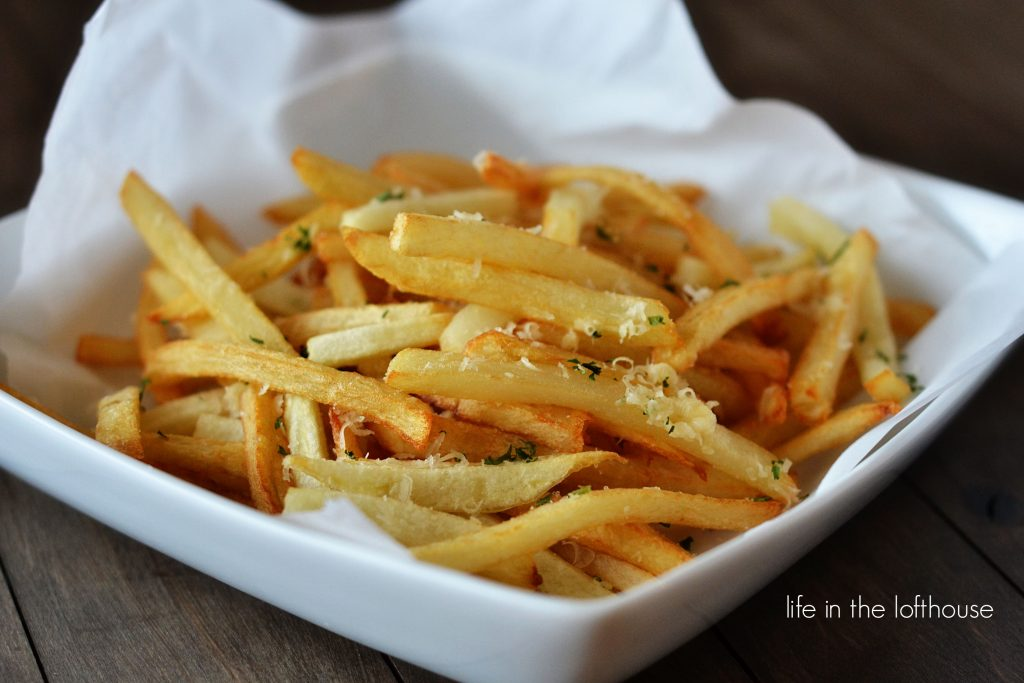 Garlic Parmesan french fries are perfect double-fried french fries coated with Parmesan cheese, garlic and parsley. Life-in-the-Lofthouse.com