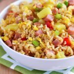 Hawaiian Fried Rice is full of flavor and packed with diced ham, red bell pepper, and pineapple. Life-in-the-Lofthouse.com