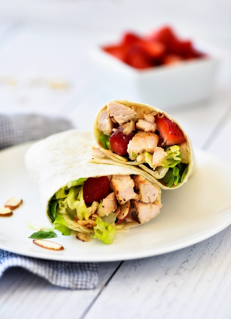 Strawberry Chicken Wraps are filled with grilled chicken, romaine lettuce, creamy poppy seed dressing and strawberries. Life-in-the-Lofthouse.com