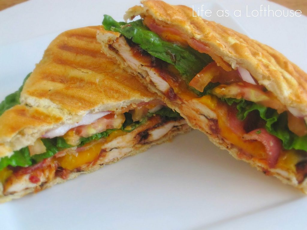 This BBQ Chicken Panini is filled with BBQ sauce, grilled chicken, bacon, red onion, lettuce and tomato. Life-in-the-Lofthouse.com