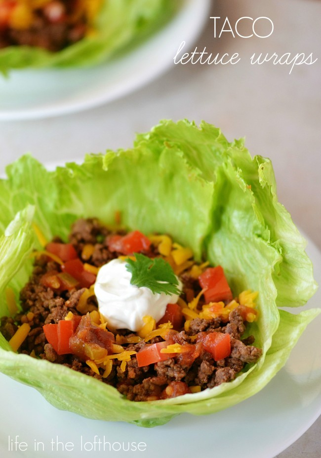 Taco lettuce wraps are taco seasoned ground beef, tomatoes, cheese and sour cream wrapped up inside lettuce leaves. Life-in-the-Lofthouse.com