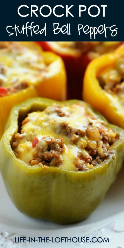 Crock Pot Stuffed Bell Peppers are cooked in the crock pot and filled with ground beef, Mexican rice, enchilada sauce and cheese. Life-in-the-Lofthouse.com