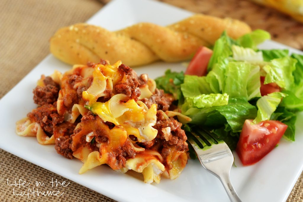 Noodles, ground beef, tomato sauce, sour cream and lots of cheese are all inside this sour cream noodle bake. Life-in-the-Lofthouse.com