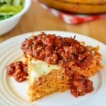 Spaghetti Pie is tossed in four cheeses and a quick and easy homemade meat sauce. Life-in-the-Lofthouse.com