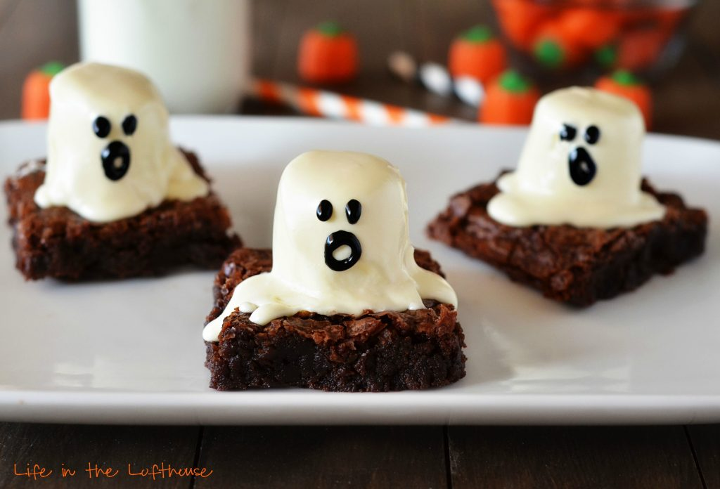 Ghost brownies are delicious, soft brownies with a large cake frosting covered marshmallow on top with an adorable ghost face. Life-in-the-Lofthouse.com
