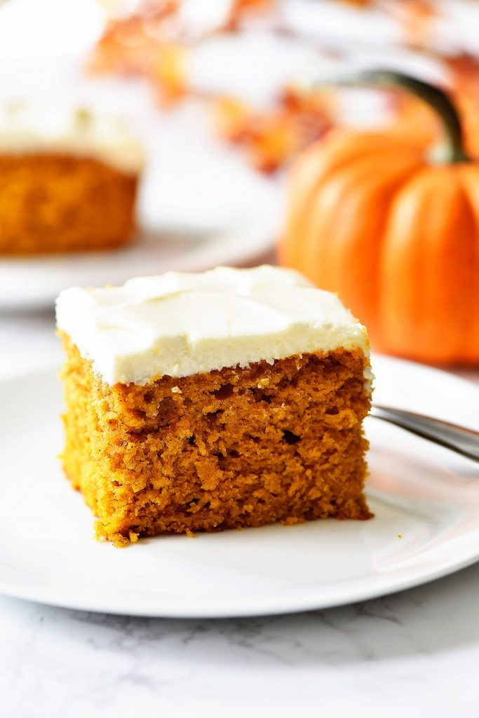 Pumpkin Cake with Cream Cheese frosting is a moist and fluffy pumpkin cake with the perfect cream cheese frosting topping it. Life-in-the-Lofthouse.com