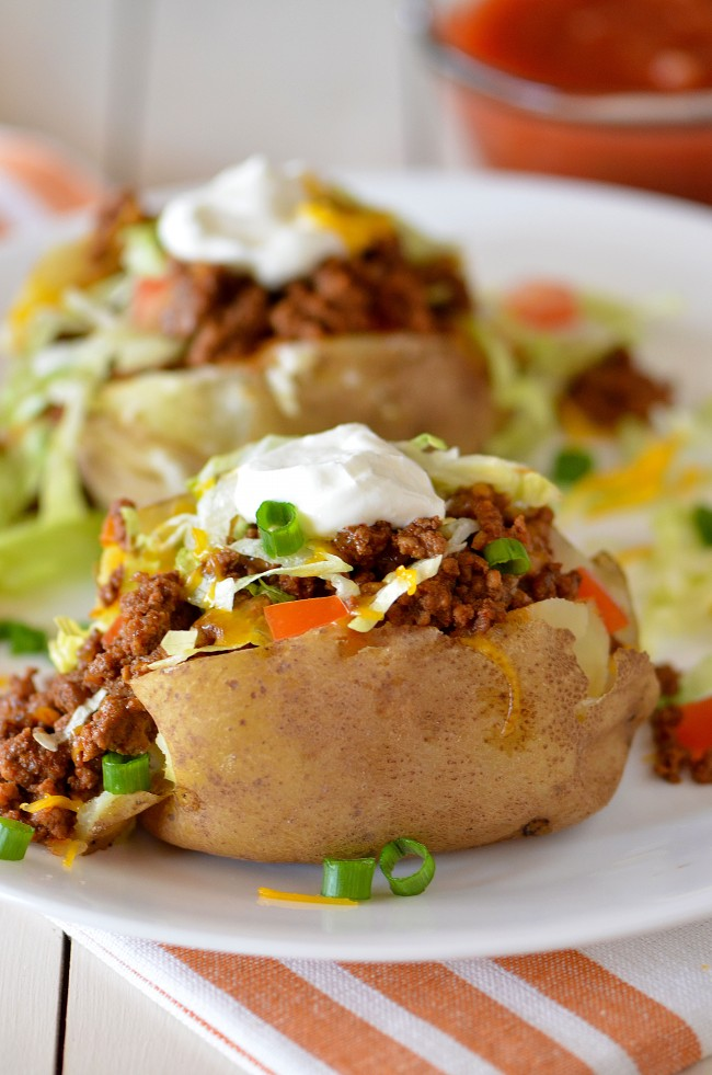 Baked potatoes topped with taco fillings. These are so good!