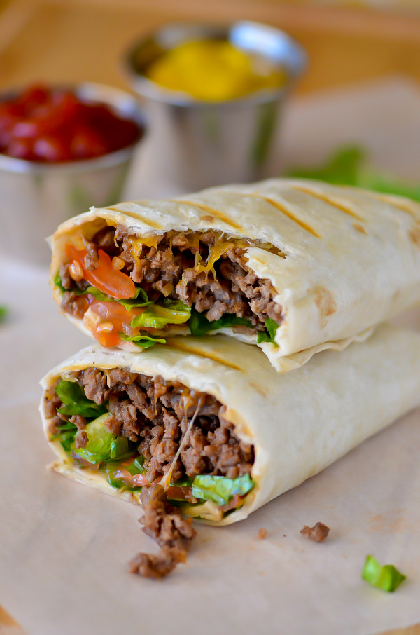 Bacon Cheeseburger Wraps have all the components of a bacon cheeseburger wrapped up in a flour tortilla. Life-in-the-Lofthouse.com