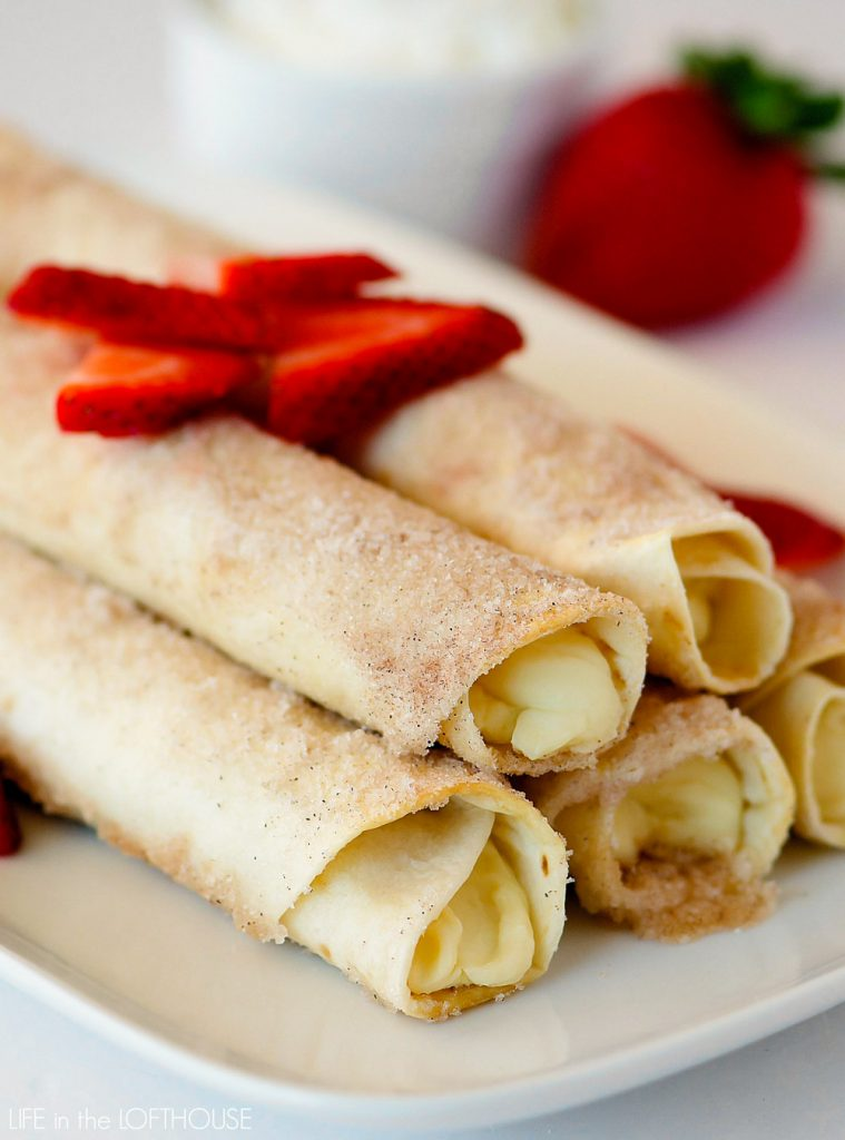 Cheesecake Taquitos have a silky-smooth cheesecake filling wrapped inside a crispy flour tortilla that's been rolled in cinnamon and sugar. Life-in-the-Lofthouse.com