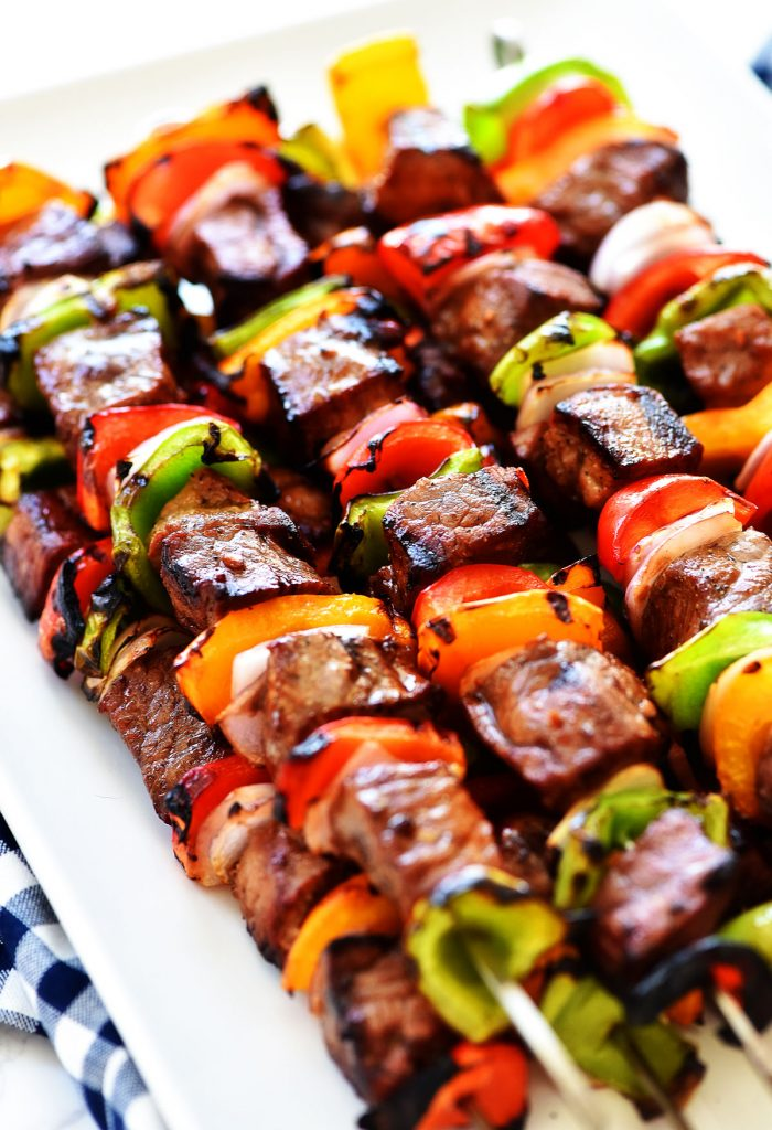 Grilled Steak Kebabs are made of delicious marinated steak pieces with bell peppers and red onion. Life-in-the-Lofthouse.com