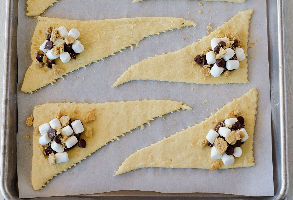 Flaky, buttery crescent rolls stuffed with Nutella, marshmallows, chocolate chips and graham cracker. Life-in-the-Lofthouse.com