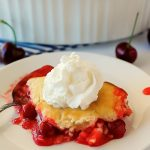 Easy Cherry Cobbler has a biscuit and cake-like crust over a bed of warm cherry pie filling. Life-in-the-Lofthouse.com