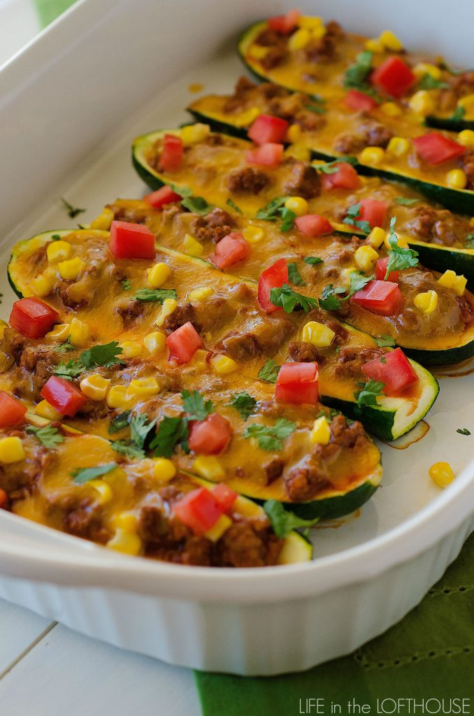 Beef enchilada zucchini boats are full of seasoned ground beef, homemade enchilada sauce and a couple veggies that are stuffed on top of zucchini. Life-in-the-Lofthouse.com