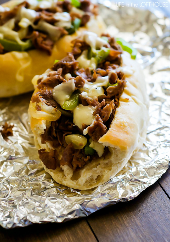 Cheesesteak sandwiches are hearty, flavorful sandwiches full of sliced steak, green pepper, onion and Provolone cheese. Life-in-the-Lofthouse.com