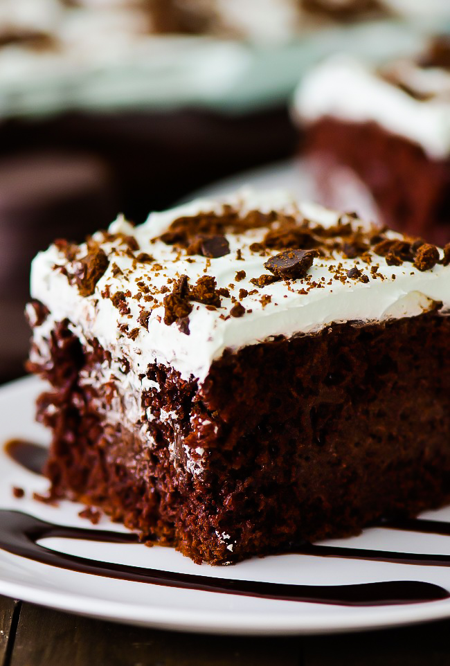This incredibleThin Mint Chocolate Poke Cake is filled with chocolate pudding, crushed thin mint cookies and topped with a creamy peppermint whipped topping. Life-in-the-Lofthouse.com