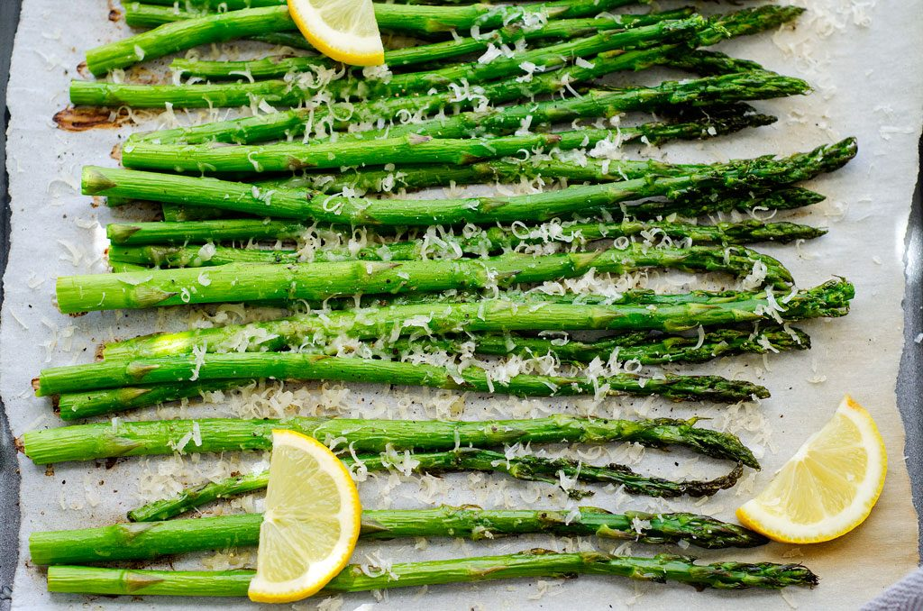 Tender-crisp asparagus that's roasted in the oven with a smidge of olive oil, fresh cracked pepper, grated parmesan cheese and a few squirts of lemon. Life-in-the-Lofthouse.com