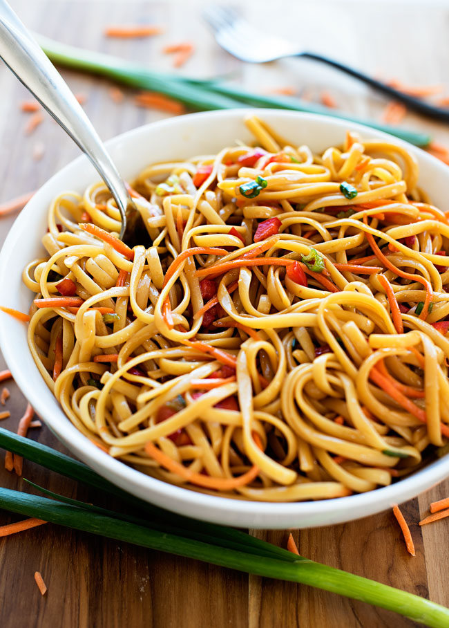 Asian pasta salad is a delicious salad made with noodles, fresh veggies and a soy sauce and brown sugar mixture. Life-in-the-Lofthouse.com