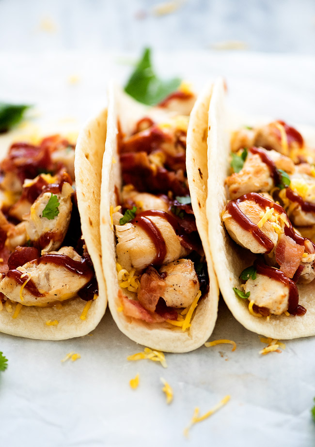 BBQ Chicken Bacon Tacos are filled with grilled chicken, bacon, cheese and barbecue sauce all inside a flour tortilla. Life-in-the-Lofthouse.com