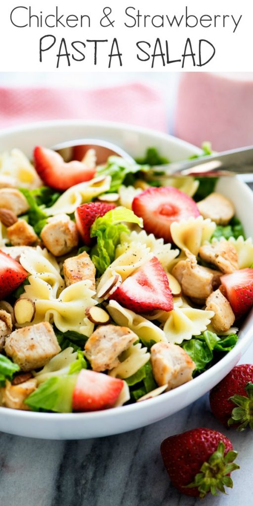 Chicken Strawberry Pasta Salad is loaded with grilled chicken, sliced strawberries, almonds, bow tie pasta and romaine lettuce. Life-in-the-Lofthouse.com