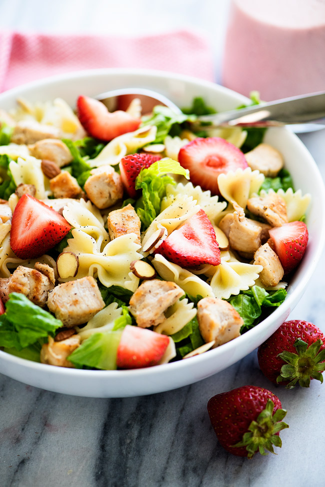 This salad is loaded with grilled chicken, strawberries, bow tie noodles and romaine lettuce. We love to pour poppy seed dressing over the top!