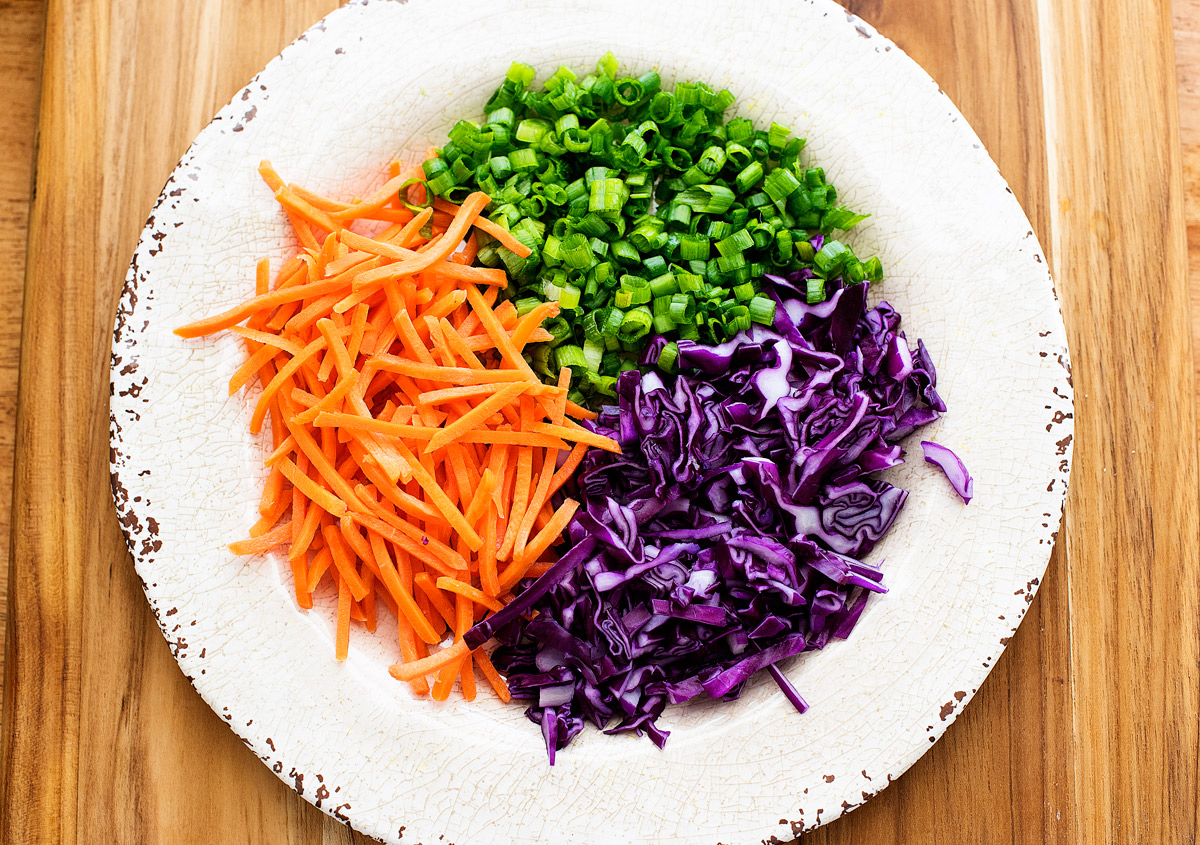 Shredded carrots, green onion and red cabbage for Chinese chicken salad!