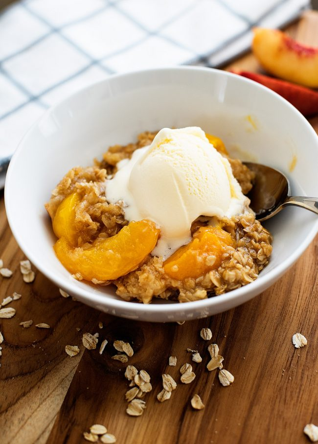 Peach Crisp starts with a bottom layer of flaky, buttery pastry and sweet peach filling and is then covered in a crumbly oatmeal streusel topping. Life-in-the-Lofthouse.com