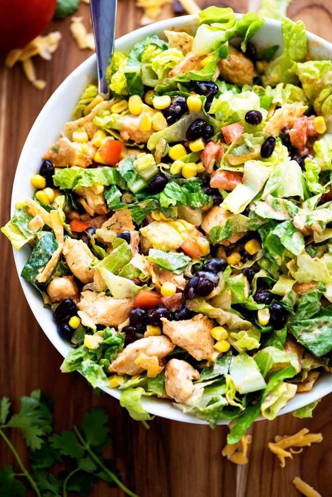 A delicious chopped salad filled with crunchy romaine lettuce, corn, black beans, tomatoes, green onion and grilled chicken. Life-in-the-Lofthouse.com