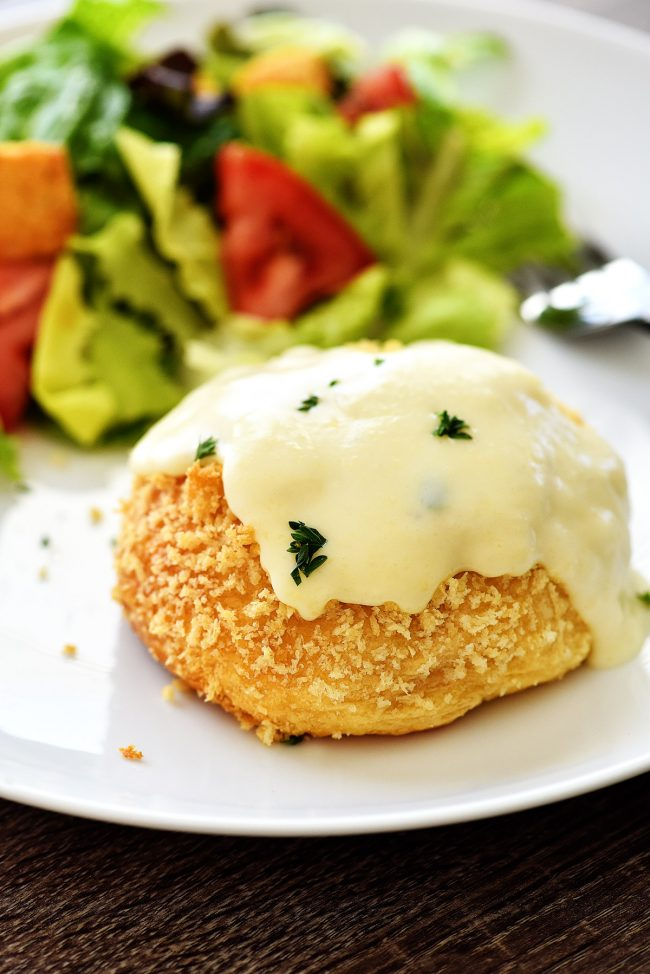Chicken Pillows with Creamy Parmesan Sauce are filled with a flavorful chicken mixture tucked inside flaky crescent dough. Life-in-the-Lofthouse.com
