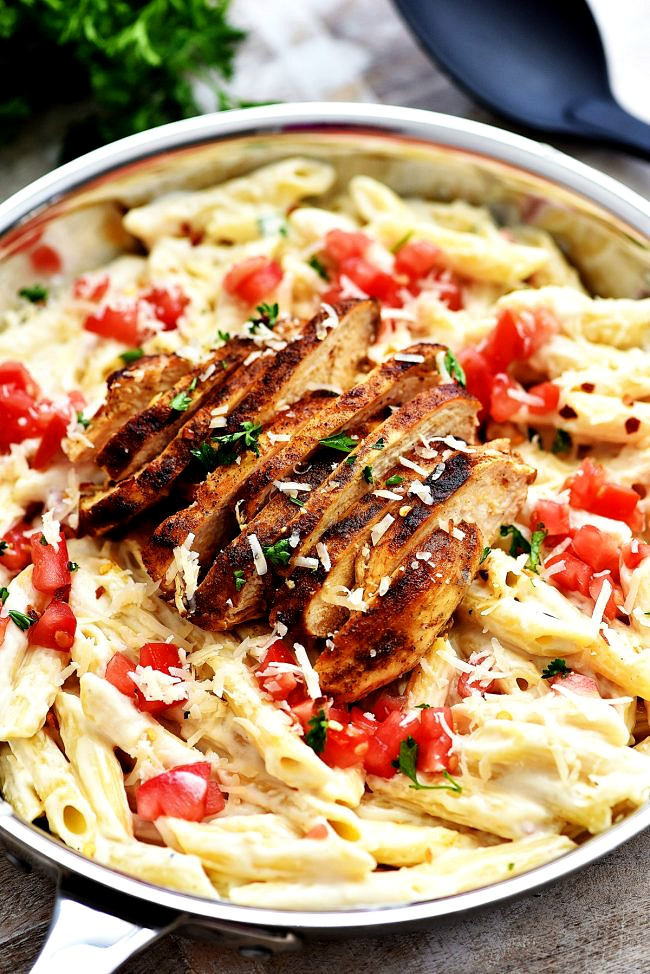 Cajun-chicken, tomatoes and Parmesan Cheese topped over a bed of creamy penne pasta. Life-in-the-Lofthouse.com