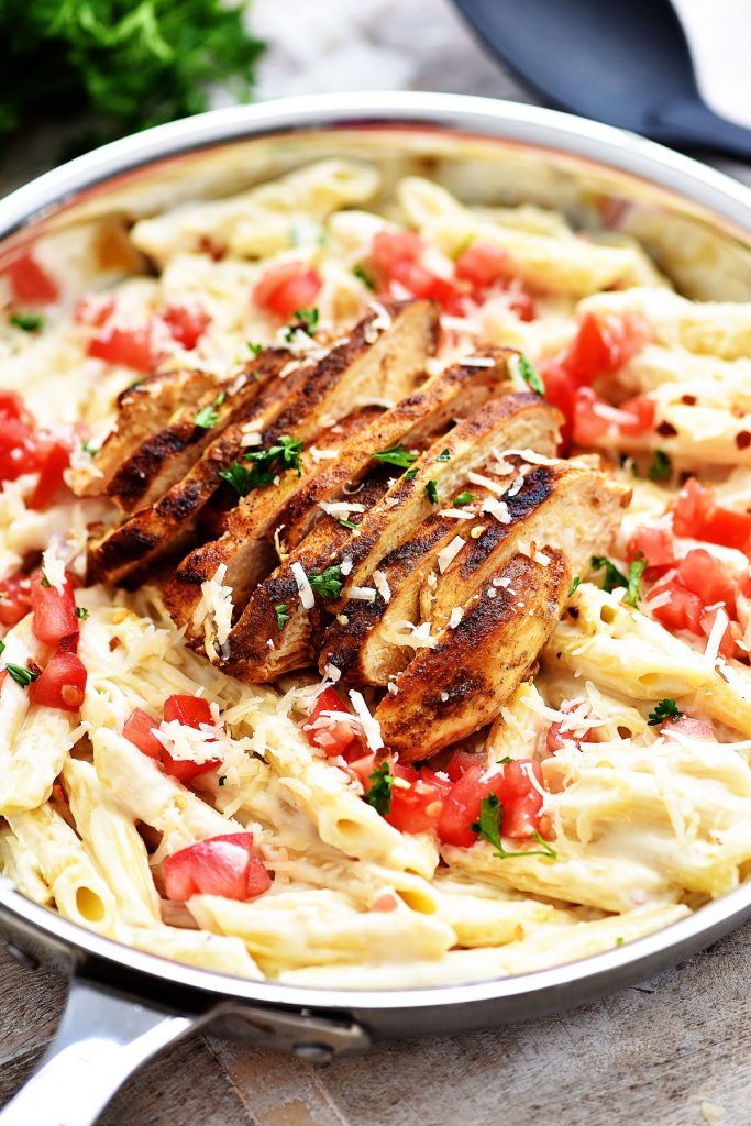 Cajun chicken, homemade alfredo and penne pasta all in this comfort dish!