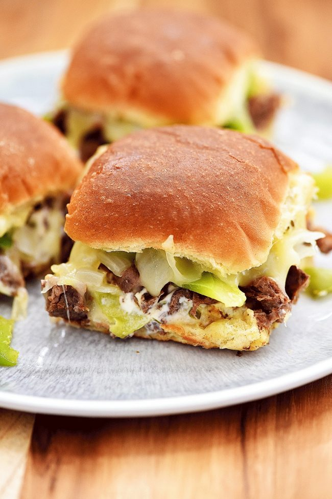 Steak, onions and lots of gooey cheese in these easy sliders