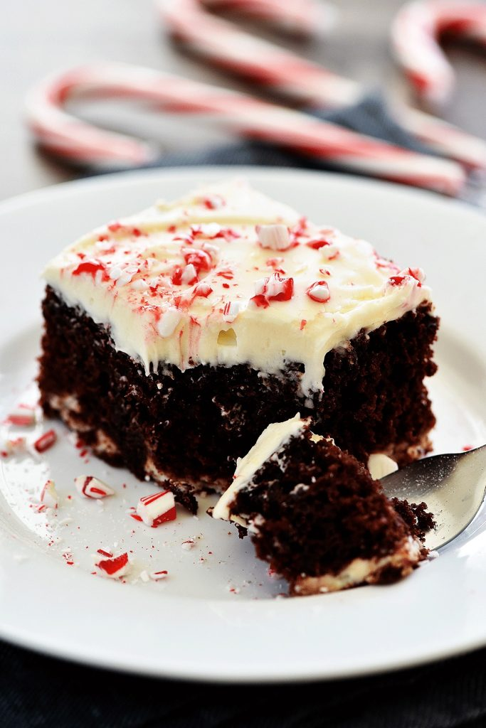 Chocolate Candy Cane Cheesecake Cake is a moist, chocolatey cake filled with swirls of cheesecake topped off with cream cheese frosting and crushed candy canes. Life-in-the-Lofthouse.com
