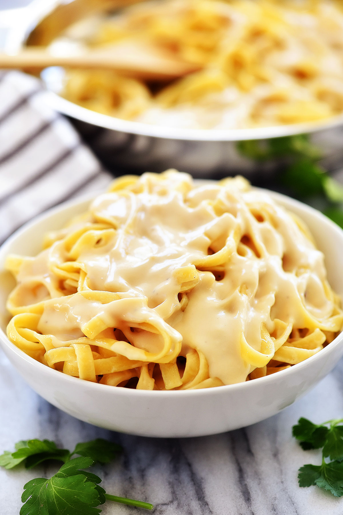 This fettuccine Alfredo is a creamy Italian pasta that uses lighter ingredients. Life-in-the-Lofthouse.com