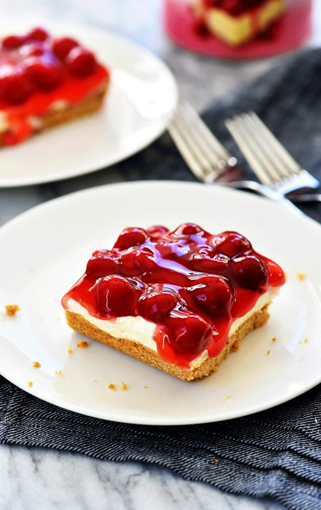 Cherry Delight is an easy dessert recipe with a graham cracker crust, a cheesecake center, and topped off with cherry pie filling. Life-in-the-Lofthouse.com