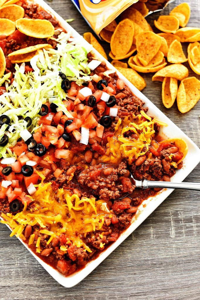 Texas Taco Dip is filled with beans, beef chili and loads of cheese. Life-in-the-Lofthouse.com