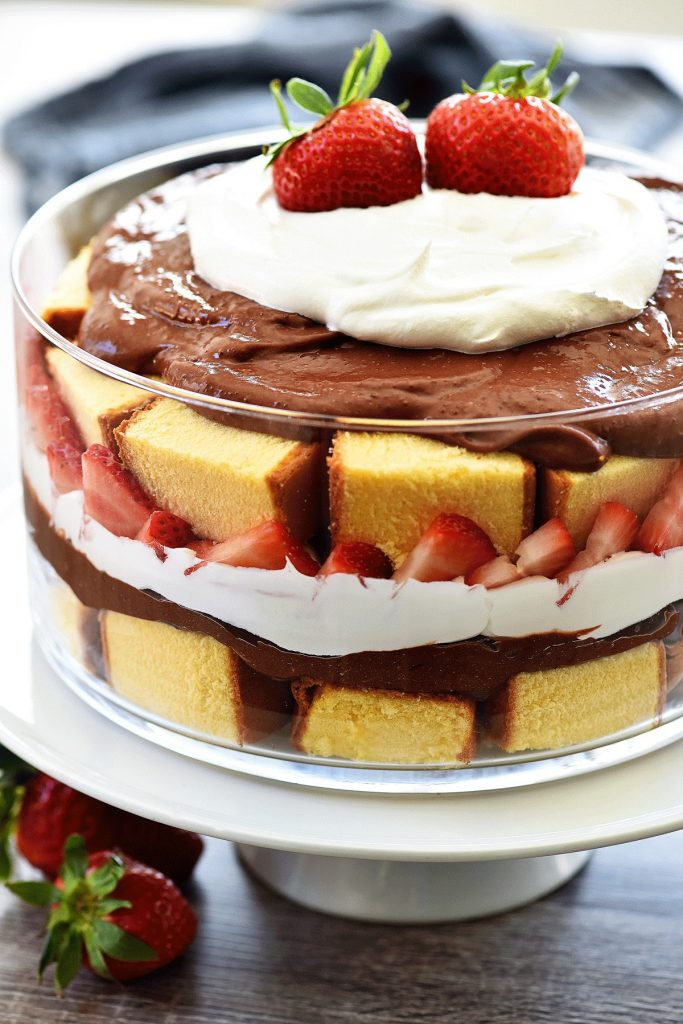 Strawberry Chocolate pound cake trifle has layers of pound cake, chocolate, whipped cream and loads of strawberries. Life-in-the-Lofthouse.com